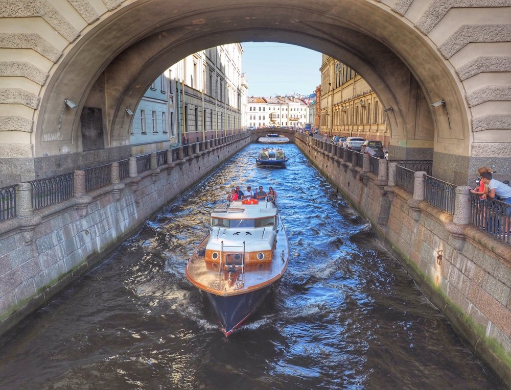 Tour boats wind through the canals of St. Petersburg, Russia, first top on our Viking Waterways of the Tsars cruise to Moscow's canals