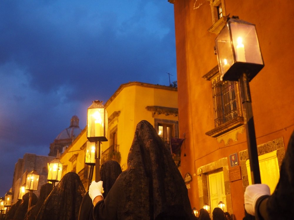 A Semana Santa procession of women dressed in black lace winds through central San Miguel de Allende
