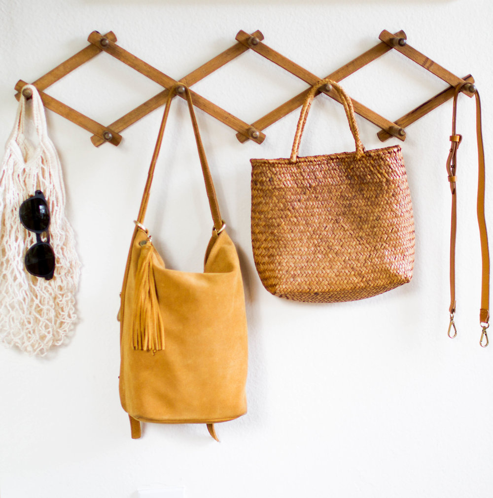 Shop Hobo Reversible Backpack  HERE    Shop $3 fish net bag  HERE   Shop similar straw bag  HERE   Shop Expandable rack  HERE