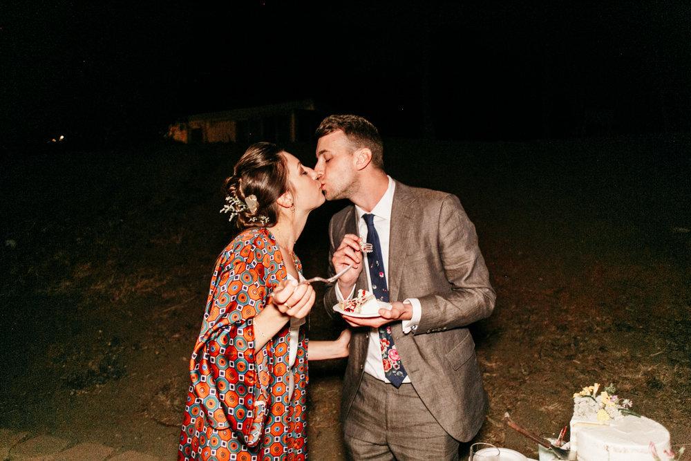 SamErica Studios - wedding cake cutting kiss