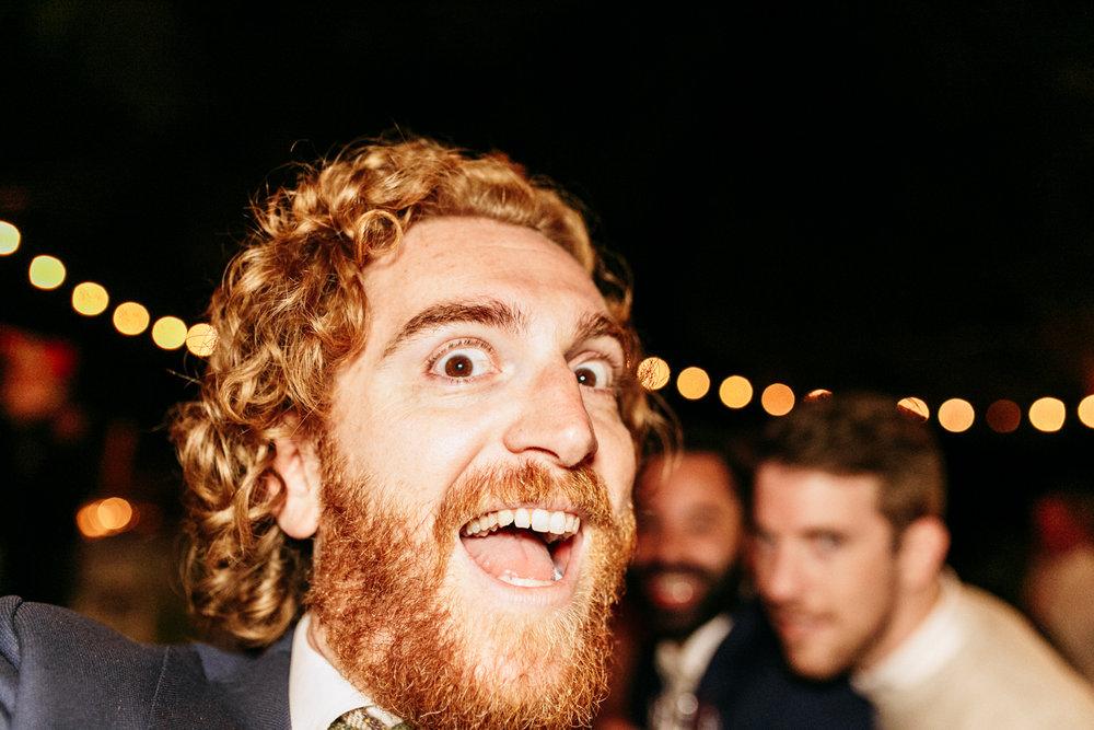 SamErica Studios -  happy ginger at wedding reception