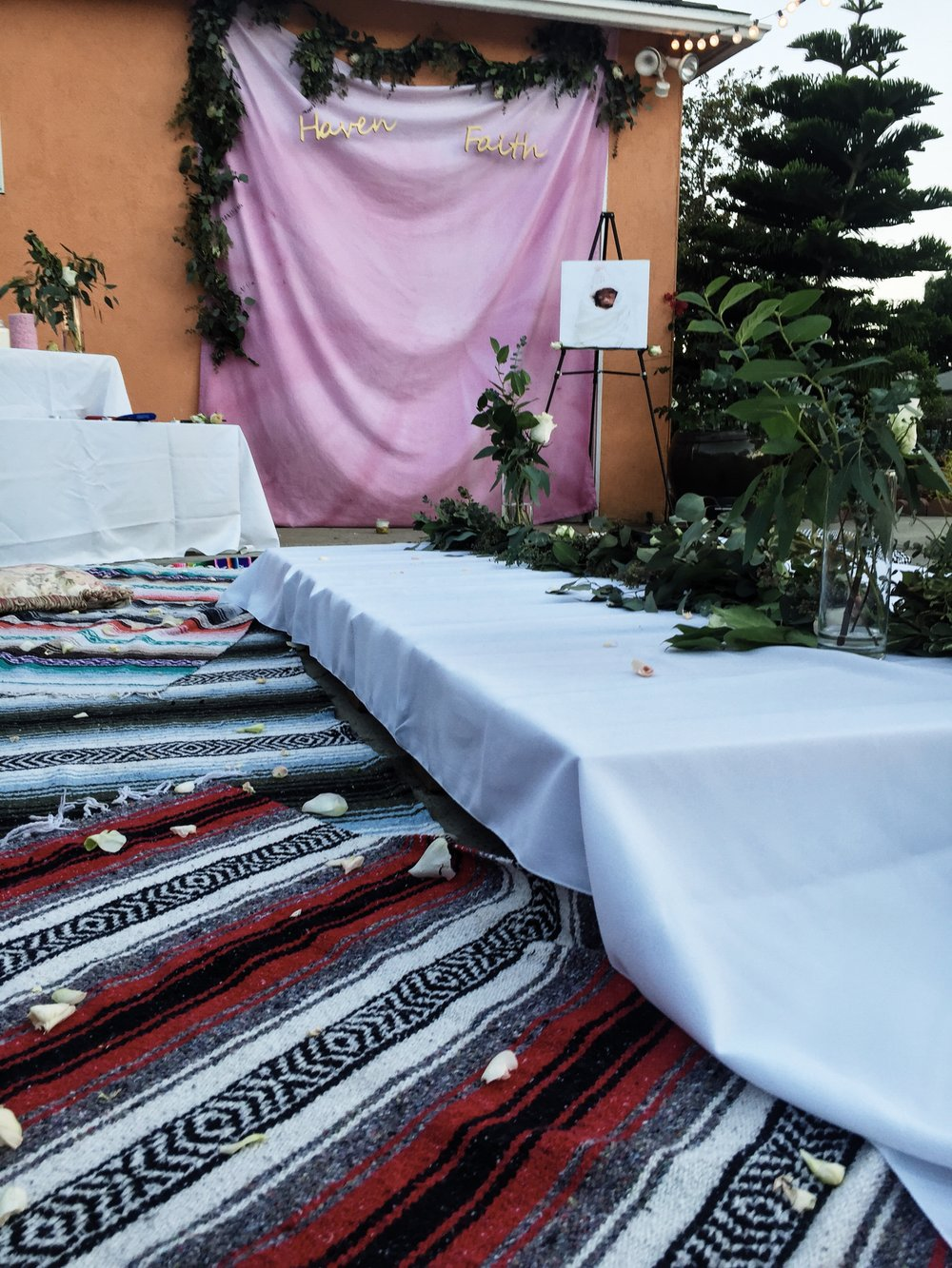 Falsa/ Mexican blankets were collected from my siblings and niece -- which we all already had in our homes. My sister & brother in law's old pallet bed was used for our table and created the bohemian theme we wanted to have. All pillows were something we already had as well.