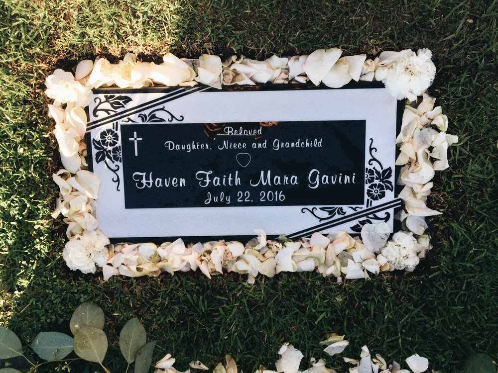 Paul, my sister, and I created her headstone together during our funeral + service planning. We knew we wanted majority of the piece to have a lot of white, flowers, a feminine font, as well as a small heart to signify how bright, big, and strong hers really was despite her heart defect.  We absolutely fell in love with how it came out.