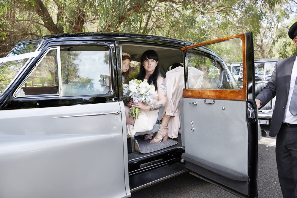 24-flowergirl-looks-out-very-nice-classics-wedding-cars-in-perth.jpg
