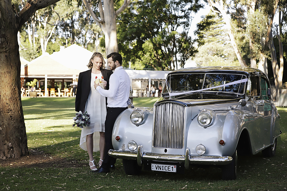 Elmars-Weddings072-very-nice-classics-wedding-cars-all-about-image-bride-in-grooms-jacket.JPG