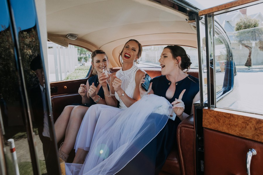 Kasse_John_Modern-Classic-Wedding_Folktales-Photography-girls-in-back-Very-Nice-Classics-wedding-car.jpg