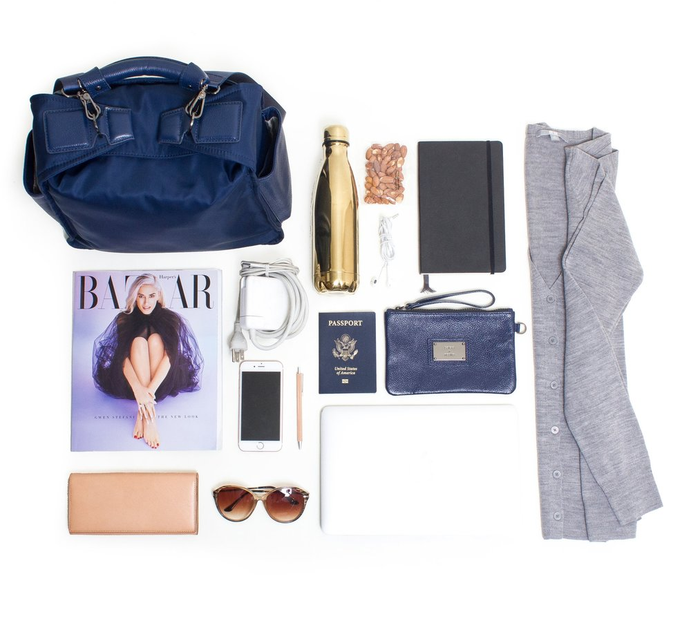 The Liukin in navy outfitted for Nastia's jetset excursions