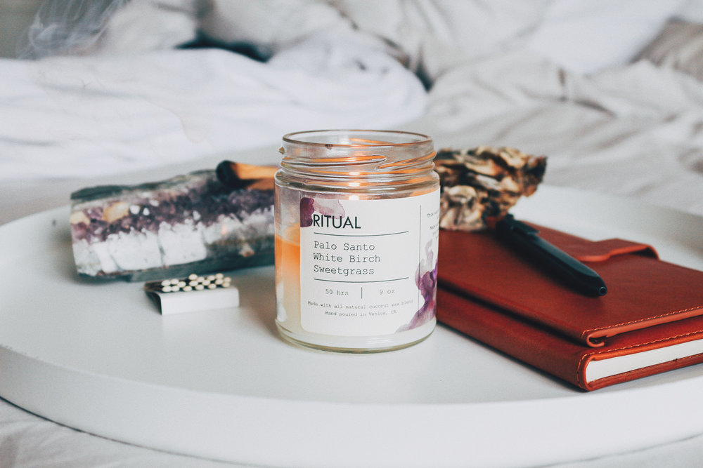 Sacred Space with an amethyst, sage for smudging, journal and pen. Of course, our Ritual candle.