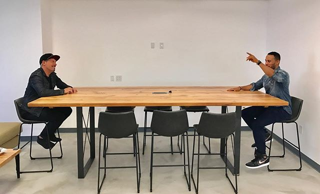 Our goal is to create a work environment that inspires creativity, productivity and collaboration. Designer Chad and Client DeVon testing out the new collaborative work table installed at Franklin Entertainment @chadpic @devonfranklin