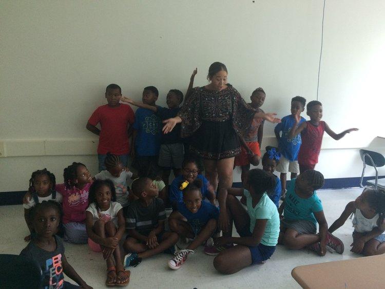 MJ Batson with art tech students at the Make A Mark Center Summer Art Tech.