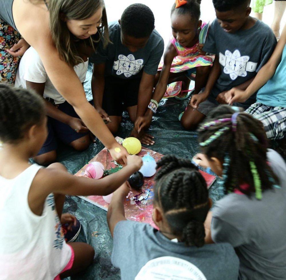 Mj Batson, founder of Make A Mark, with kids doing balloon art experiment. (Make A Mark Center, Nashville)