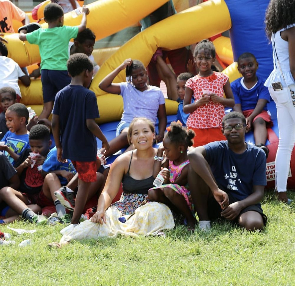 MJ with kids during end of summer celebration