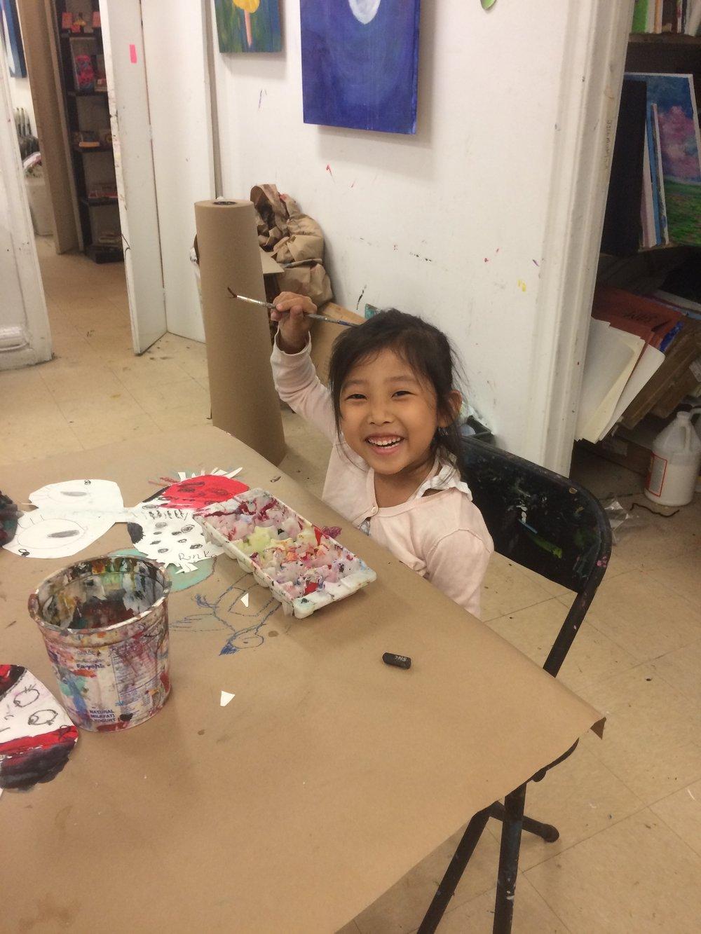 Smiling girl making art