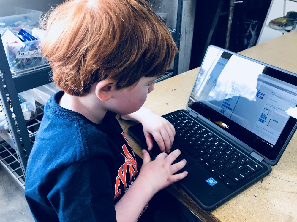 Oliver creating his first program.