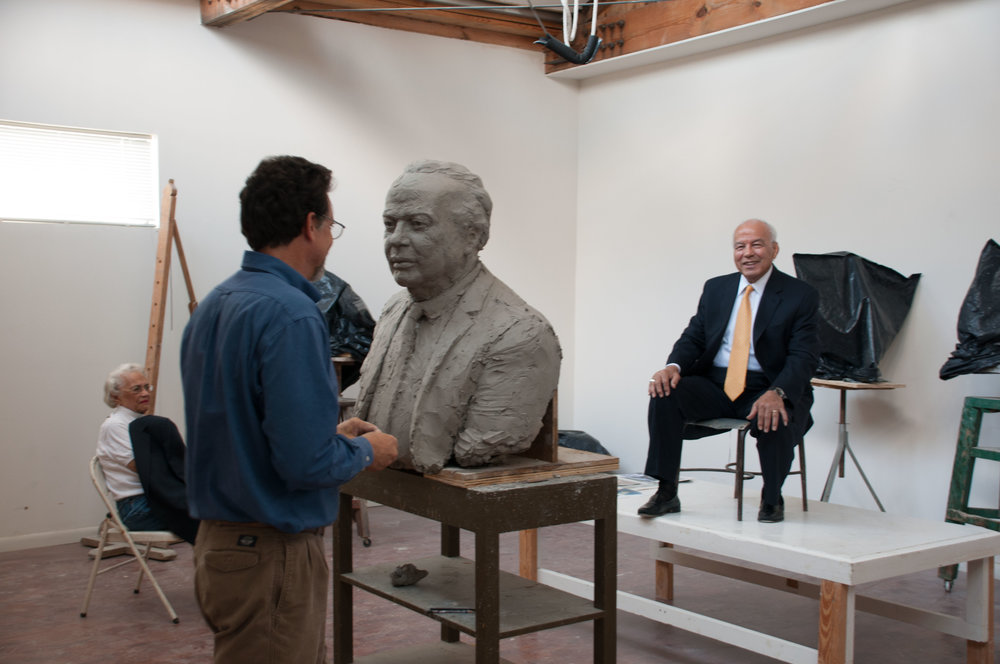 Thomas Bruno sculpting a portrait of Norman Francis, former president of Xavier University.