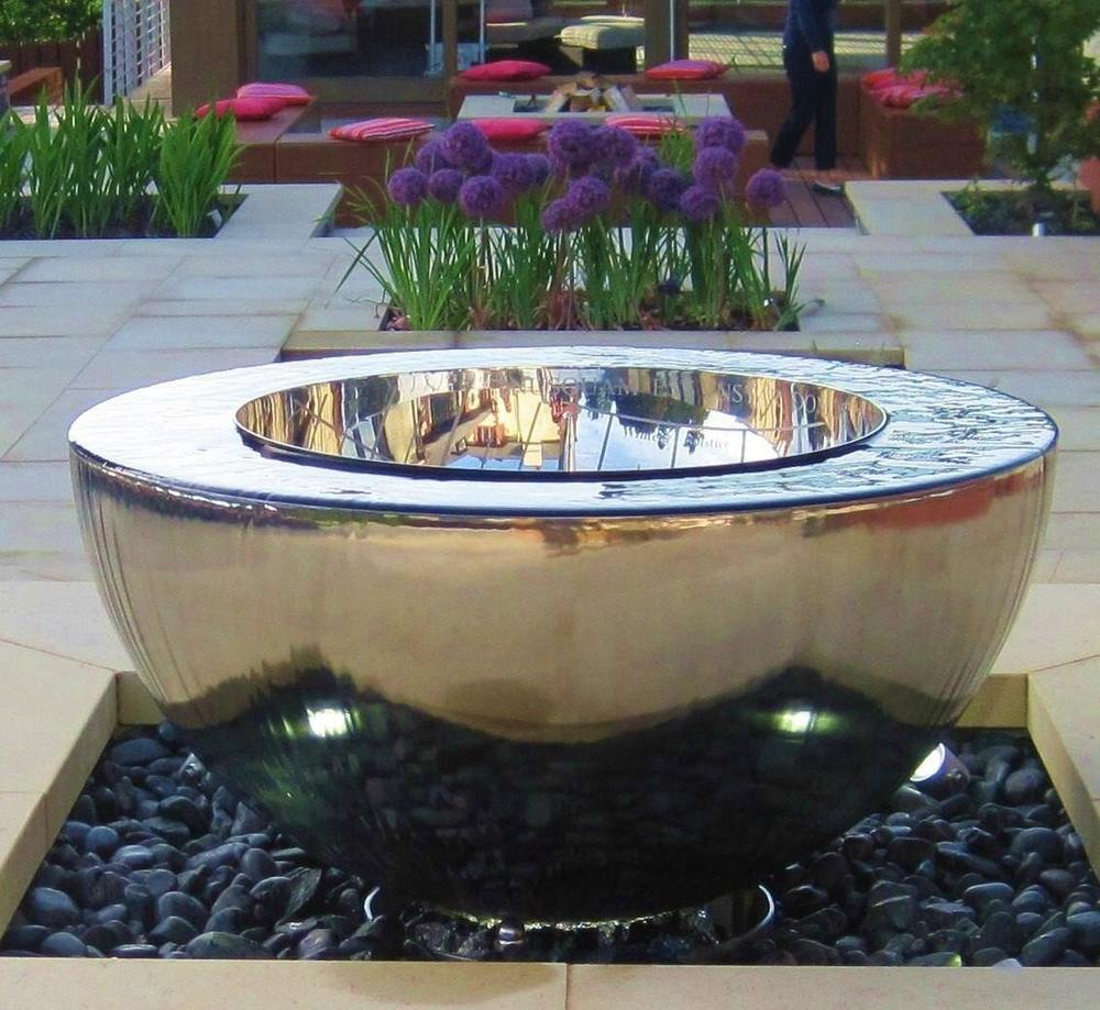 'Chalice' water feature and sundial by David Harber