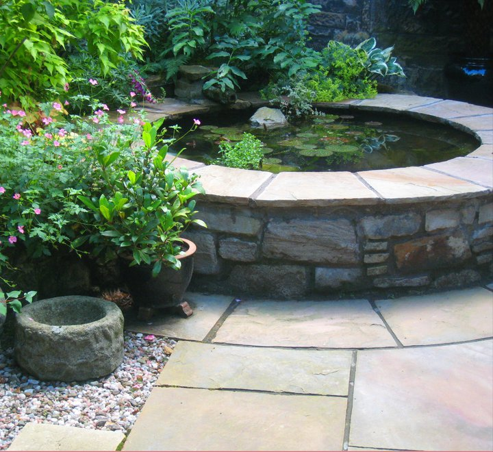 Natural stone raised pond in landscaping in Glasgow