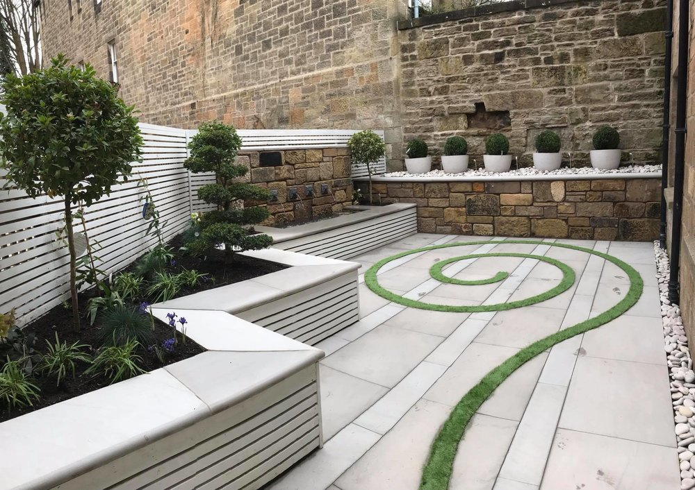 White contemporary slatted fence for a small courtyard garden in Glasgow's West End