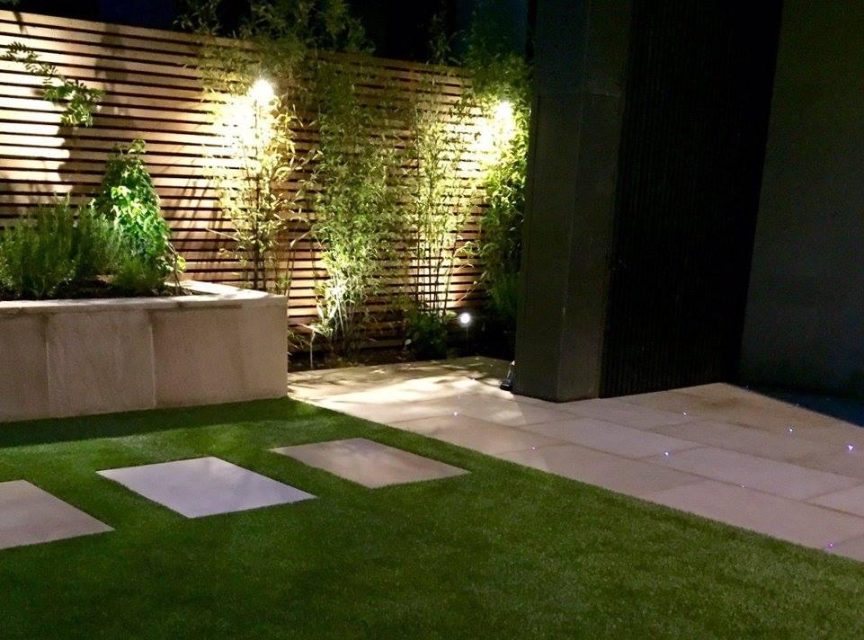 Cedar fencing for a contemporary garden in Edinburgh. This one has fibre optic lighting through the paving.