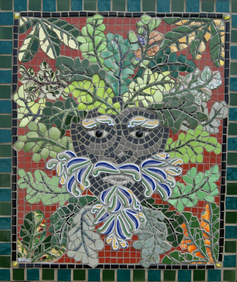 "Commission for a public house in London. This is my interpretation of the ""Green Man,"" primarily a symbol of rebirth, or ""renaissance,"" representing the cycle of growth being reborn anew each spring. Recycled ceramic, china, porcelain and glass beads on board. Mahogany edging. Approx. 36ins. x 24 ins."