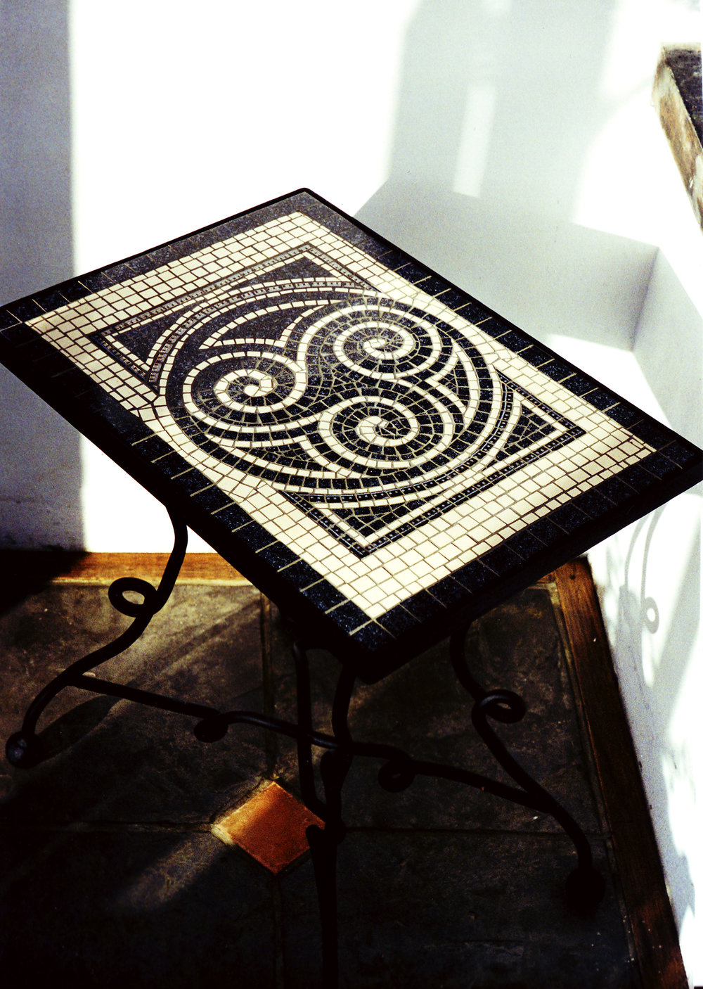 Celtic Triskele design drop-in tabletop on wrought iron base. Ceramic tile on board. Approx. 25 ins. x 18 ins.
