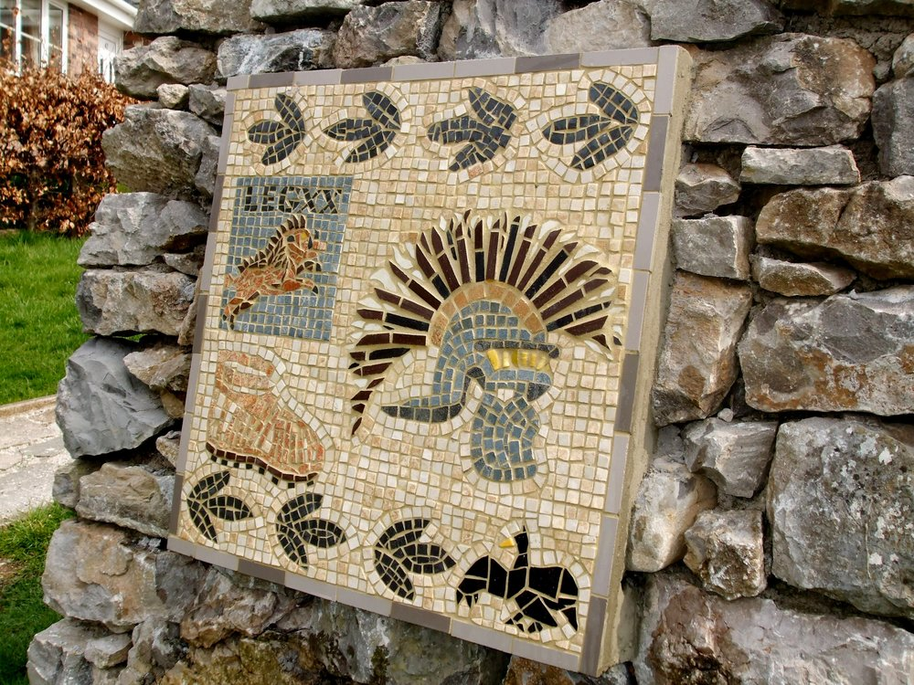 Prestatyn Roman Bathhouse, North Wales. Mosaic depicting symbols of the Roman 20th Legion stationed in Prestatyn. Part of the Merseyside Connections History Trail built in 2008 to celebrate Liverpool's Cultural Capital status. Granite, ceramic tile on a stone plinth.  https://www.tripadvisor.co.uk/Attraction_Review-g551989-d8414355-Reviews-The_Roman_Bath_House-Prestatyn_Denbighshire_North_Wales_Wales.html