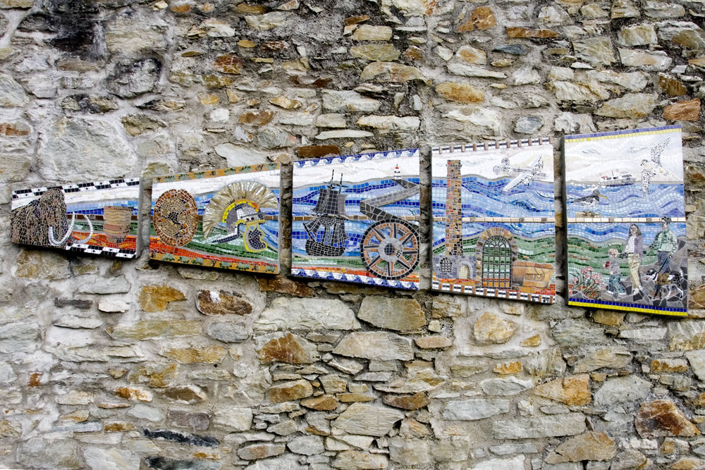 Breakwater Park, Ynys Mon, North Wales.  An Anglesey County Council commission of a timeline mosaic in five sections, telling the story of the park's long history. Ceramic, Italian smalti, vitreous glass, pebbles, brick shards on fibreglass mesh set into cement. Approx. 457 mm x 5 mm x 1.5m.    http://www.anglesey.gov.uk/Journals/2012/04/27/nature-trail-leaflet.pdf