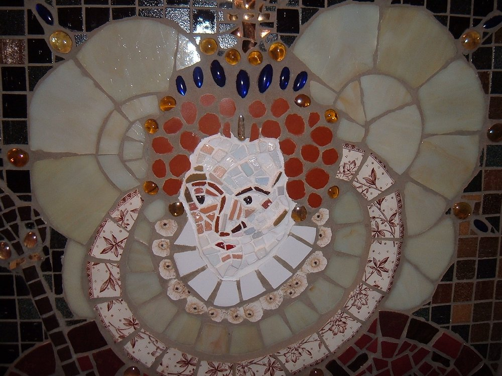 """Elizabeth 1"" mosaic sold at the Durrell Wildlife Conservation Trust charity auction held at BAFTA, Piccadilly, London in 2011  My interpretation for an exhibition themed 'Leading Light' . In an age when women had no civil rights and little power over their own lives, Queen Elizabeth I was the most powerful person of her time. She is my vision of a leading light.  Approx. 36ins x 48ins. Stained glass, vitreous glass, recycled china crockery, ceramic and glass beads on board."