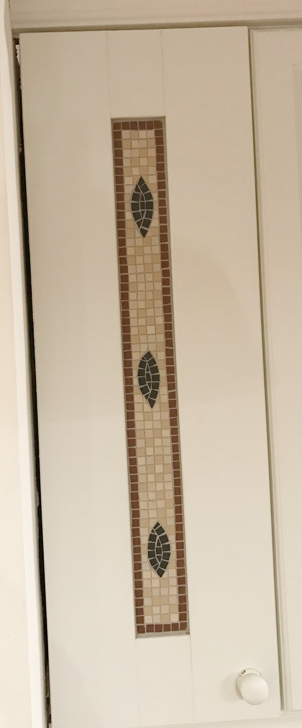 Kitchen cupboard door mosaic inset.