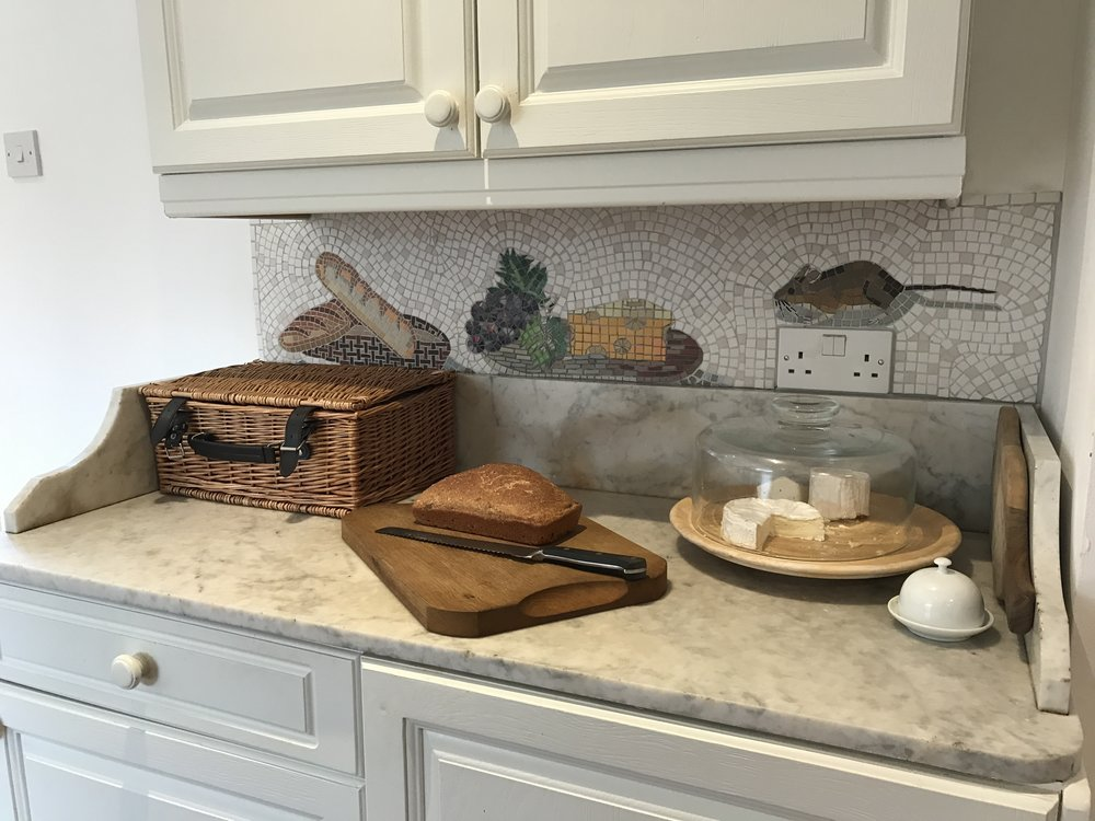 and here is the finished splashback mosaic in the breakfast room ... cheeky mousey climbs over the electricity socket on his hunt for the cheese ;)