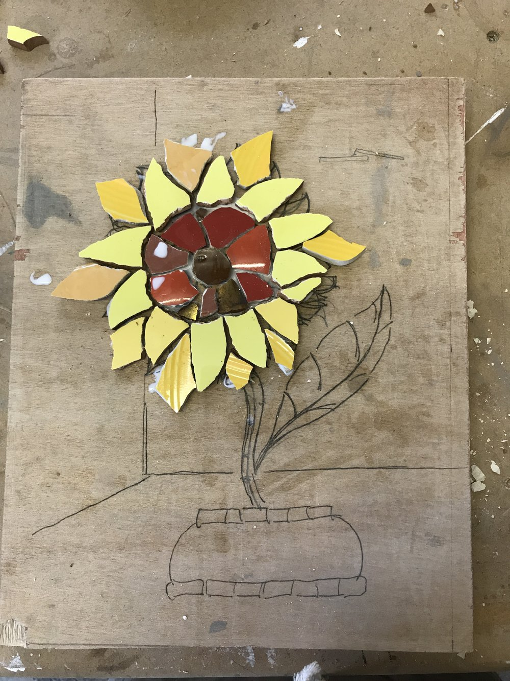Sunflower mosaic in recycled crockery, ceramic and vitreous glass