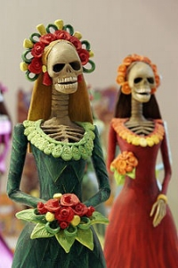 "All dolled up for 'Day of the Dead""   (decorations for Dia de los Muertos)"