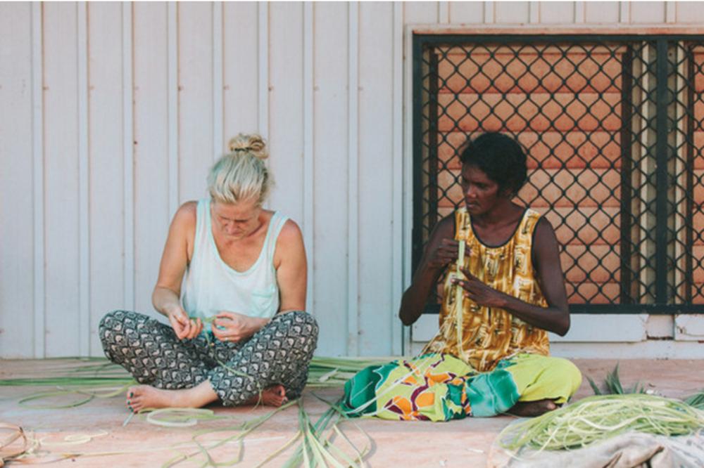 Titchkosky, left, and Ganambarr weave pandanus on Elcho Island.Photo by Shantanu Starick