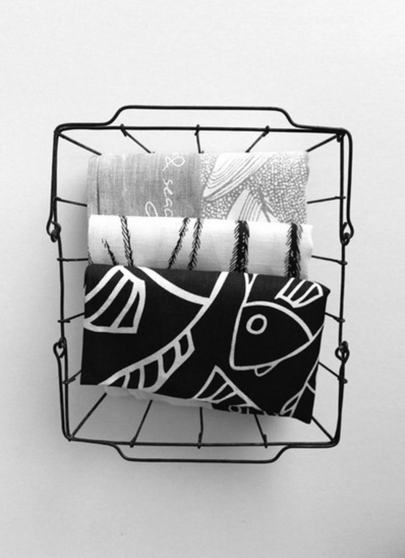 Gaawaa Miyay printed tea towels include Crow & Seagull, top, Dhinawan (Emu Feather) and Guduu-Bidi (Big Fish).Photo by Gaawaa Miyay