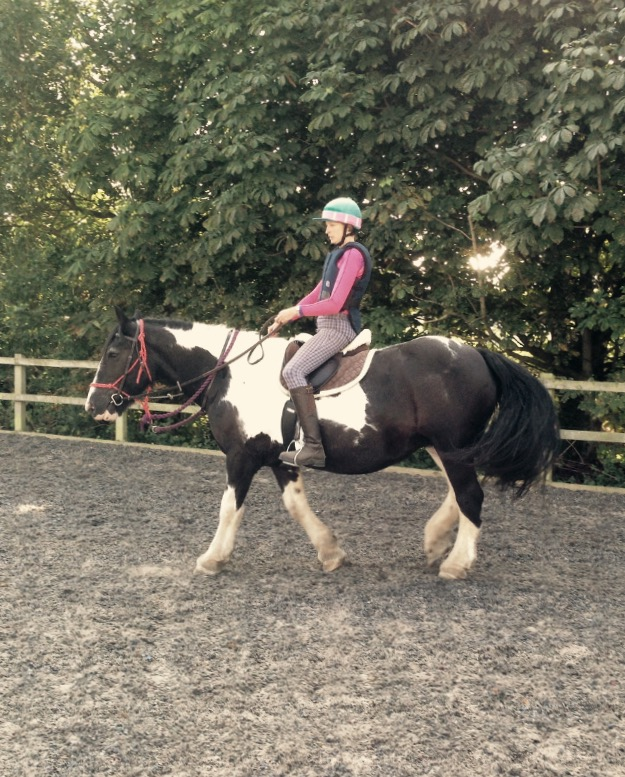 April & Emma - April came to Emma as being recently back and ridden away. It was clear to Emma that April had some worries about being ridden. April was re-backed by Jade & Emma. This is Emma riding April, their first time together in a outdoor arena.