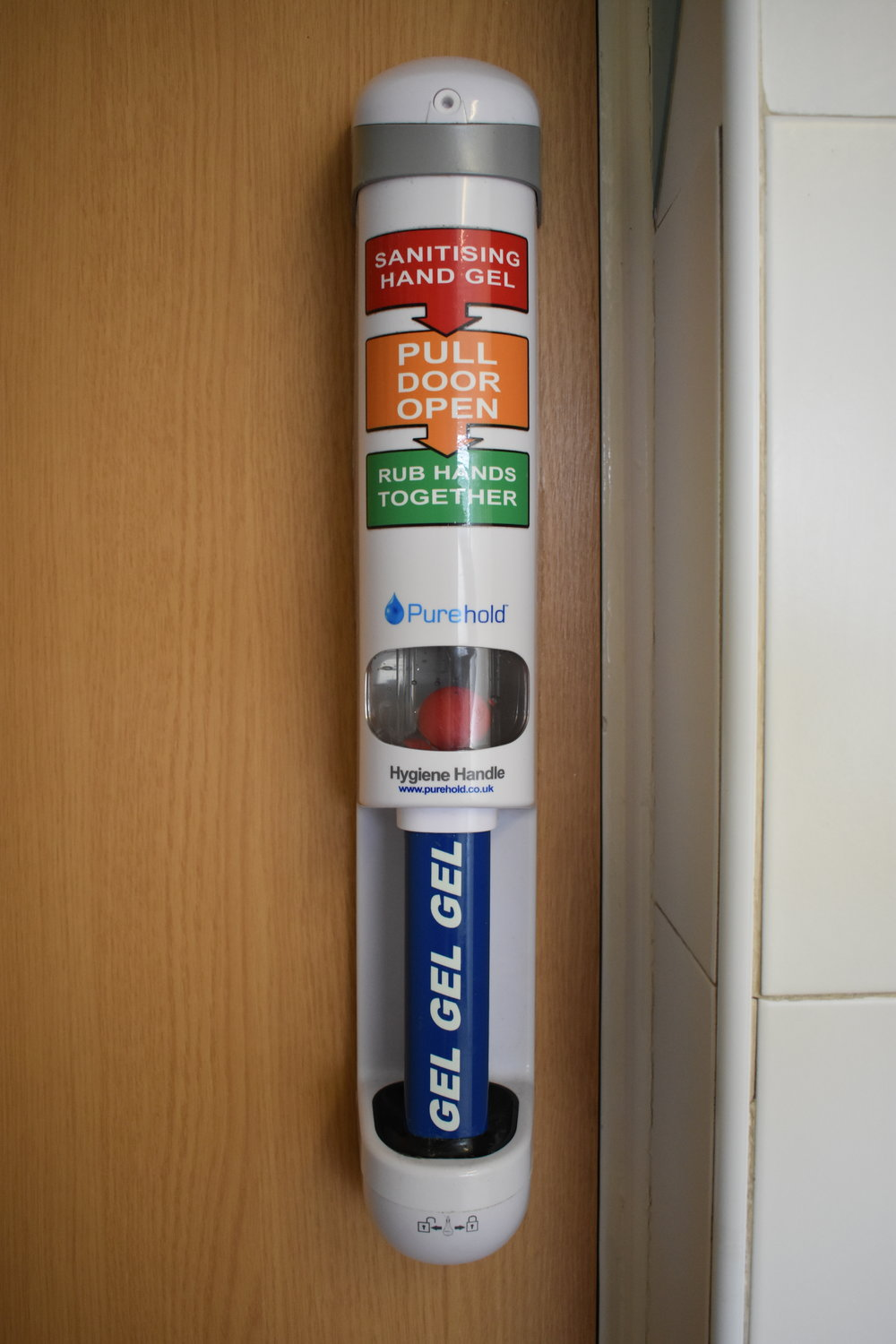 Hand sanitise door handle - helping to make sure people sanitise their hands when leaving the bathroom