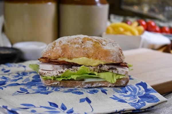 Brown Ciabatta with lettuce, grilled chicken, bacon and melted cheese