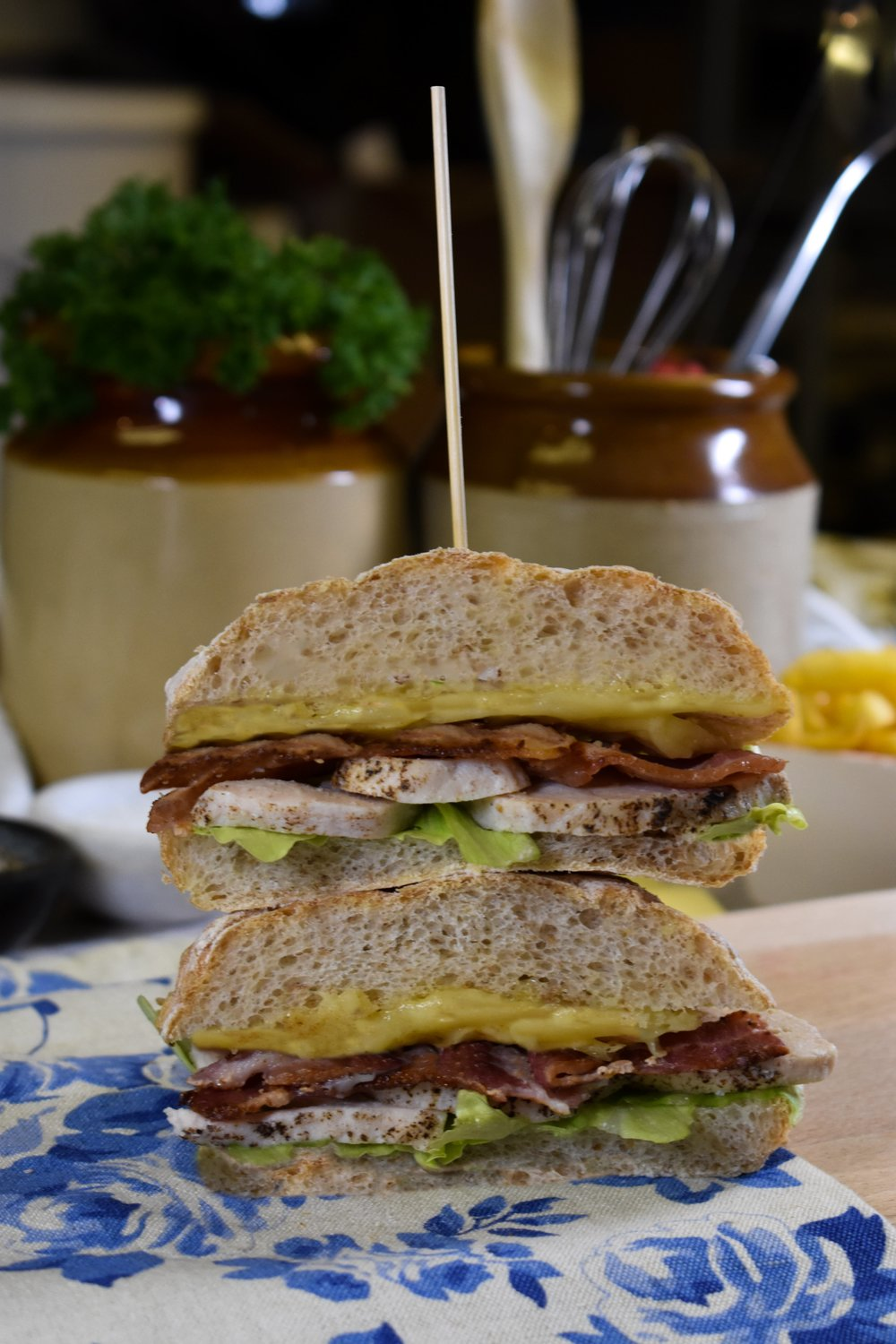 Brown Ciabatta filled with lettuce, chicken, bacon and melted cheese