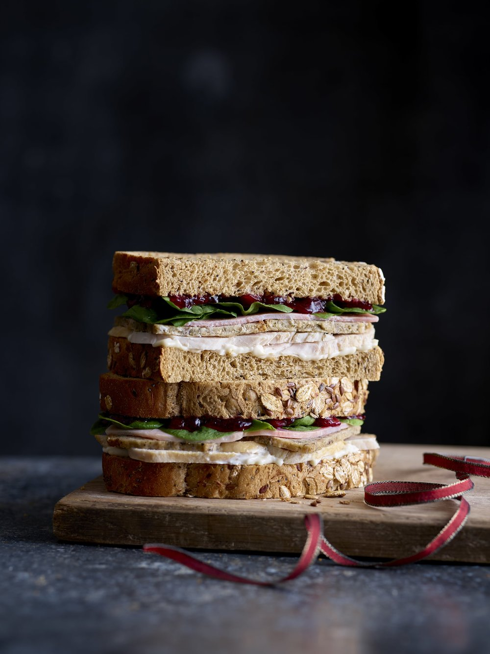 CHRISTMAS DINNER ON SEEDED BREAD - EAT have secured another spot with their festive full works bloomer! This sandwich includes butter basted turkey, sage and onion stuffing, some savoury smokiness, cranberry sauce and mayo for some extra moisture sandwiched between lovely seeded bread. This has scored highly across The Mirror with a 4, Daily Mail with a 5 and also in iNews with a 4.1 overall as the turkey scored 4 out of 5, the extras scored 4 out of 5 and bread got a 5 out of 5.