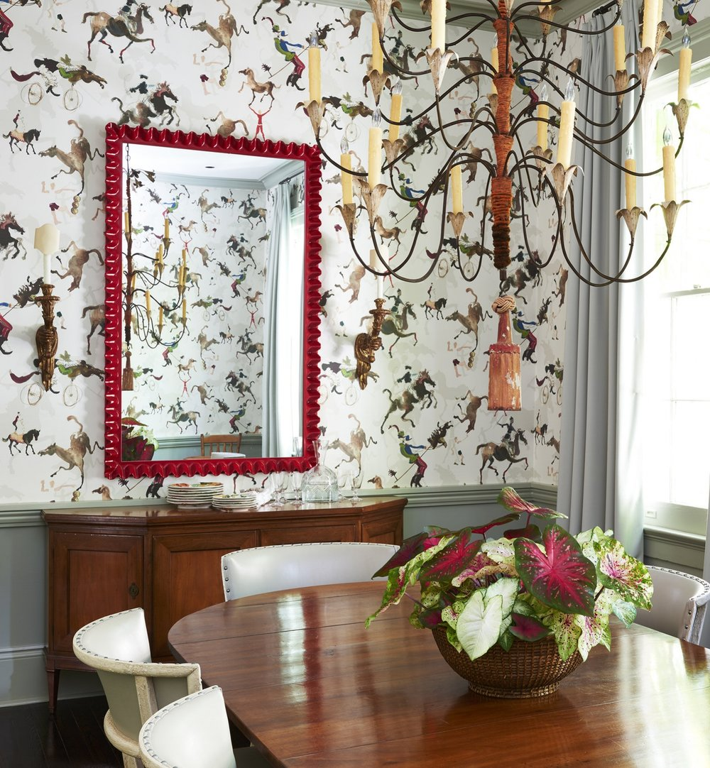 The wallpaper in the dining room is a nod to New Orleans street performers.