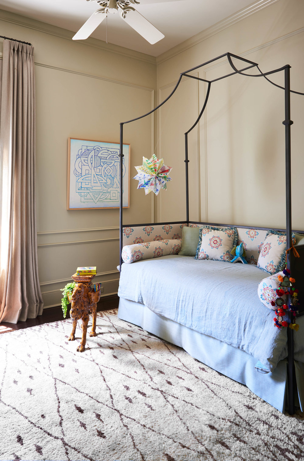 A custom-forged iron daybed in one of the girls' rooms.