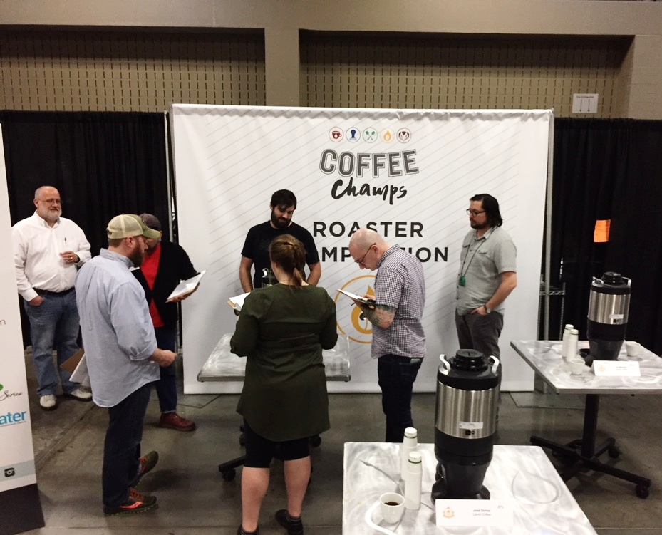 Eric presenting his coffee to the judges.