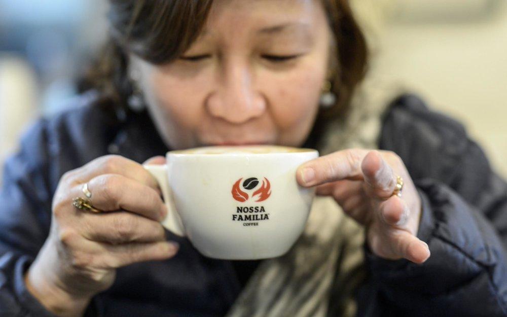 Evelyn Laviña Sips a Cappuccino at Nossa Familia