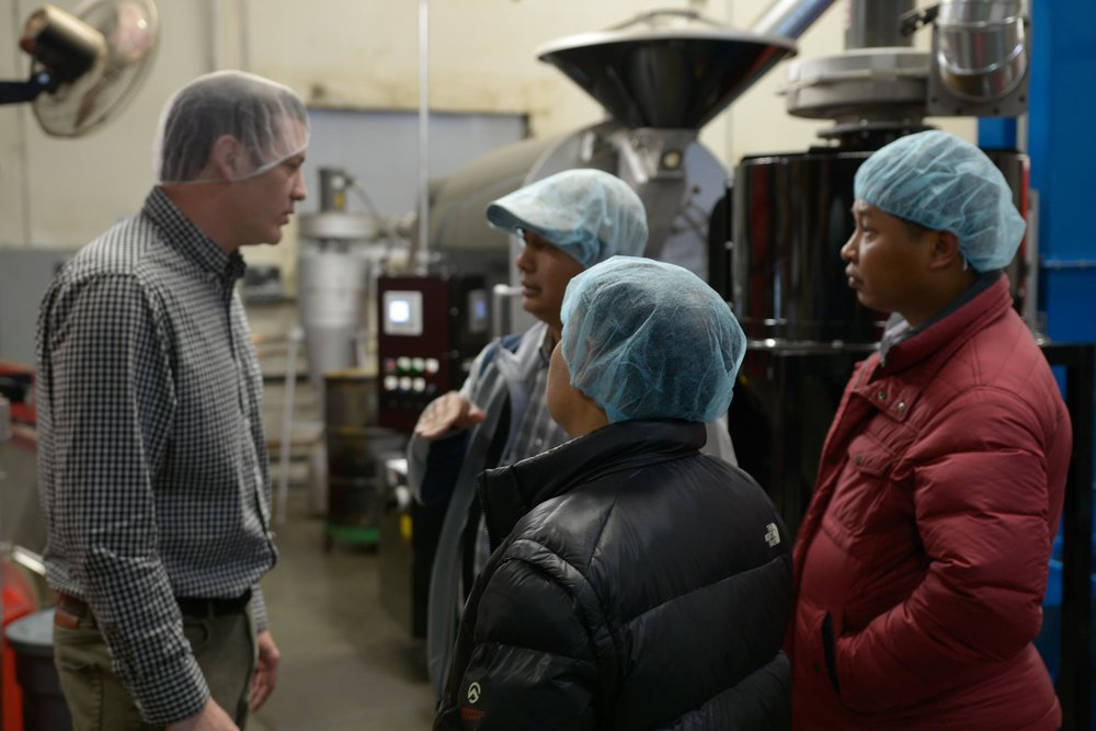 Phil Beattie Guides the Port to Cup Tour at Dillanos Coffee Roasters Facility in Sumner, Washington