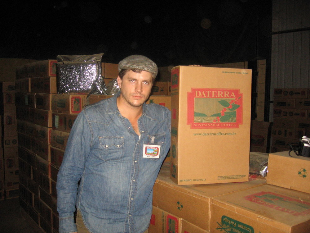 A photo of a much younger me at Daterra's warehouse in Patrocinio, learning about their Penta System for quality control, including the vacuum-sealed boxes.