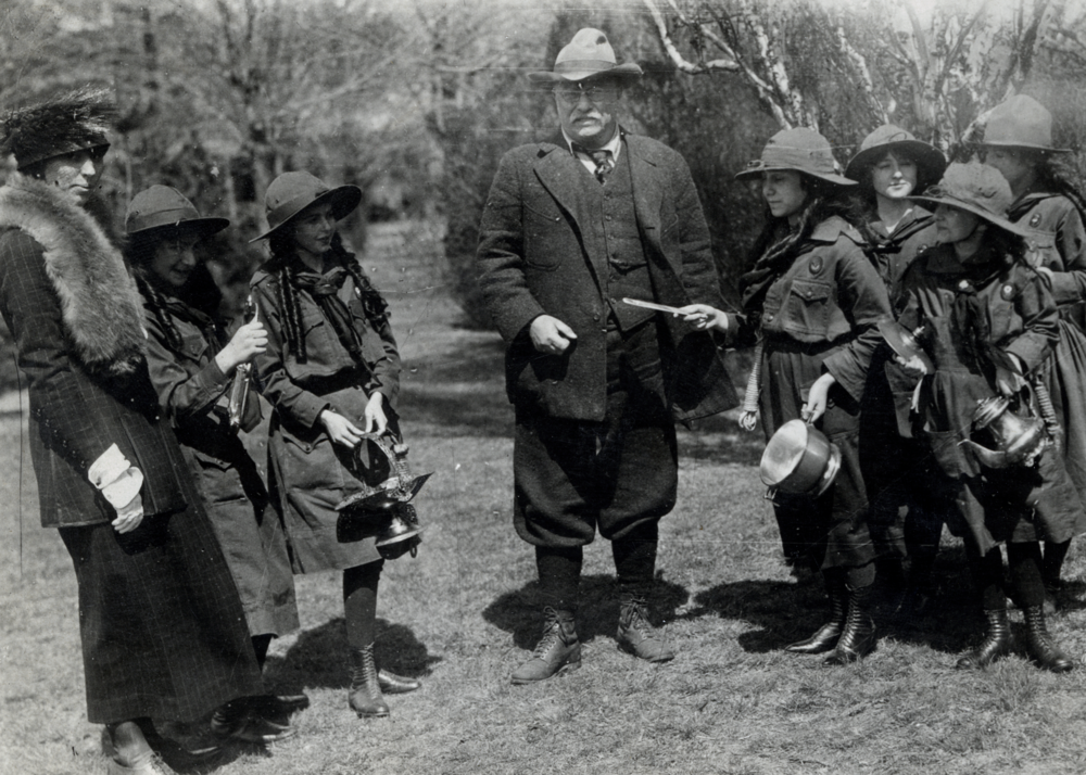 """Colonel Roosevelt giving his family silver to the Girl Scouts to be melted and the proceeds used to buy comforts for the soldiers,"" 1918. Photo courtesy of the Theodore Roosevelt Birthplace National Historic Site."
