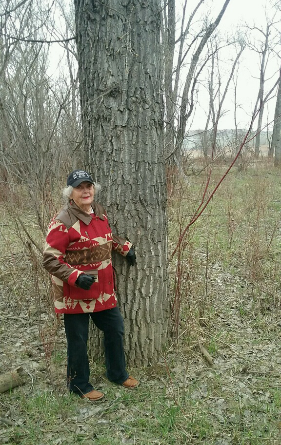 Hazel Jorgenson stands by the tree that was harvested from the Olson Jorgenson Ranch near Watford City, ND.