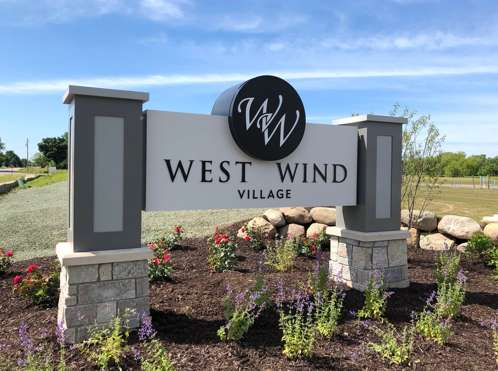 west wind village - lighted monument sign with channel logo and cnc routed faces with push thru acrylic lettering