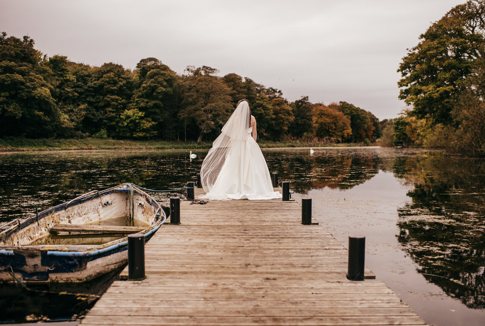 Lake jetty wedding portraits