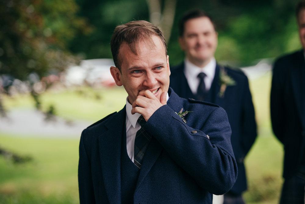 Crying groom wedding